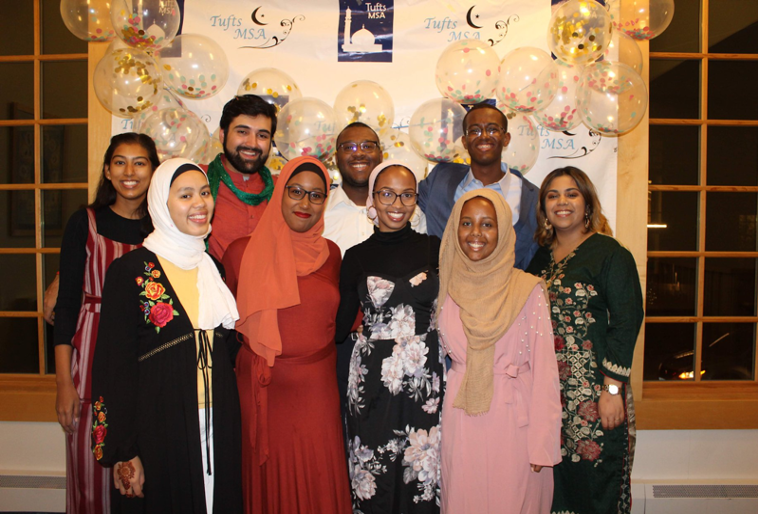 Nine members of the Muslim Student Association smile at the camera