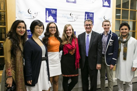Tufts University President Anthony P. Monaco a poses with his fellow guests for a photo at the Eid holiday celebration by the Muslim Students Association at Tufts on October 17, 2014