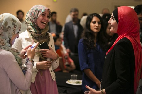 Linda Sarsour, Executive Director of the Arab American Association of New York, talks with a group of young women at the Eid holiday celebration by the Muslim Students Association at Tufts