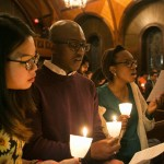 From left, Kaitlin Pang, A16, Jukurious Davis, A18, and Antonia George, A17, sing at the conclusion of the University Chaplain's office Dr. Martin Luther King Jr. Day Community Celebration at Goddard Chapel on Jan. 22, 2015.