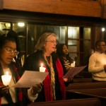 - Attendees pause for a moment of silence during a candlelight vigil at the University Chaplain's office Dr. Martin Luther King Jr. Day Community Celebration at Goddard Chapel on Jan. 22, 2015.