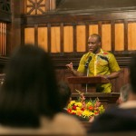 David Asamoah-Duodu, A16, recites a quotation and reflection from Dr. Martin Luther King, Jr., at the University Chaplain's office Dr. Martin Luther King, Jr. Day Community Celebration at Goddard Chapel on Jan. 22, 2015