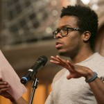 Rajah Reid, A15, performs a spoken word response at the University Chaplain's office Dr. Martin Luther King Jr. Day Community Celebration at Goddard Chapel on Jan. 22, 2015.