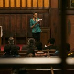 Antonia George, A17, performs a spoken word response at the University Chaplain's office Dr. Martin Luther King Jr. Day Community Celebration at Goddard Chapel on Jan. 22, 2015.