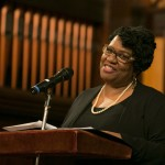 Africana Center program coordinator Denise Phillips offers remarks at the University Chaplain's office Dr. Martin Luther King Jr. Day Community Celebration at Goddard Chapel on Jan. 22, 2015.