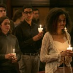 Attendees pause for a moment of silence during a candlelight vigil at the University Chaplain's office Dr. Martin Luther King Jr. Day Community Celebration at Goddard Chapel on Jan. 22, 2015.