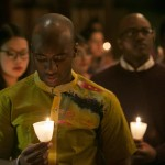 David Asamoah-Duodu, A16, pauses for a moment of silence during the candlelight vigil at the University Chaplain's office Dr. Martin Luther King Jr. Day Community Celebration at Goddard Chapel on Jan. 22, 2015.