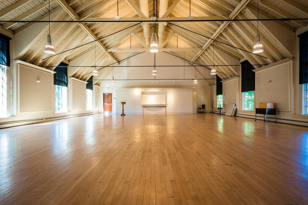 A large open room with windows and vaulted ceilings