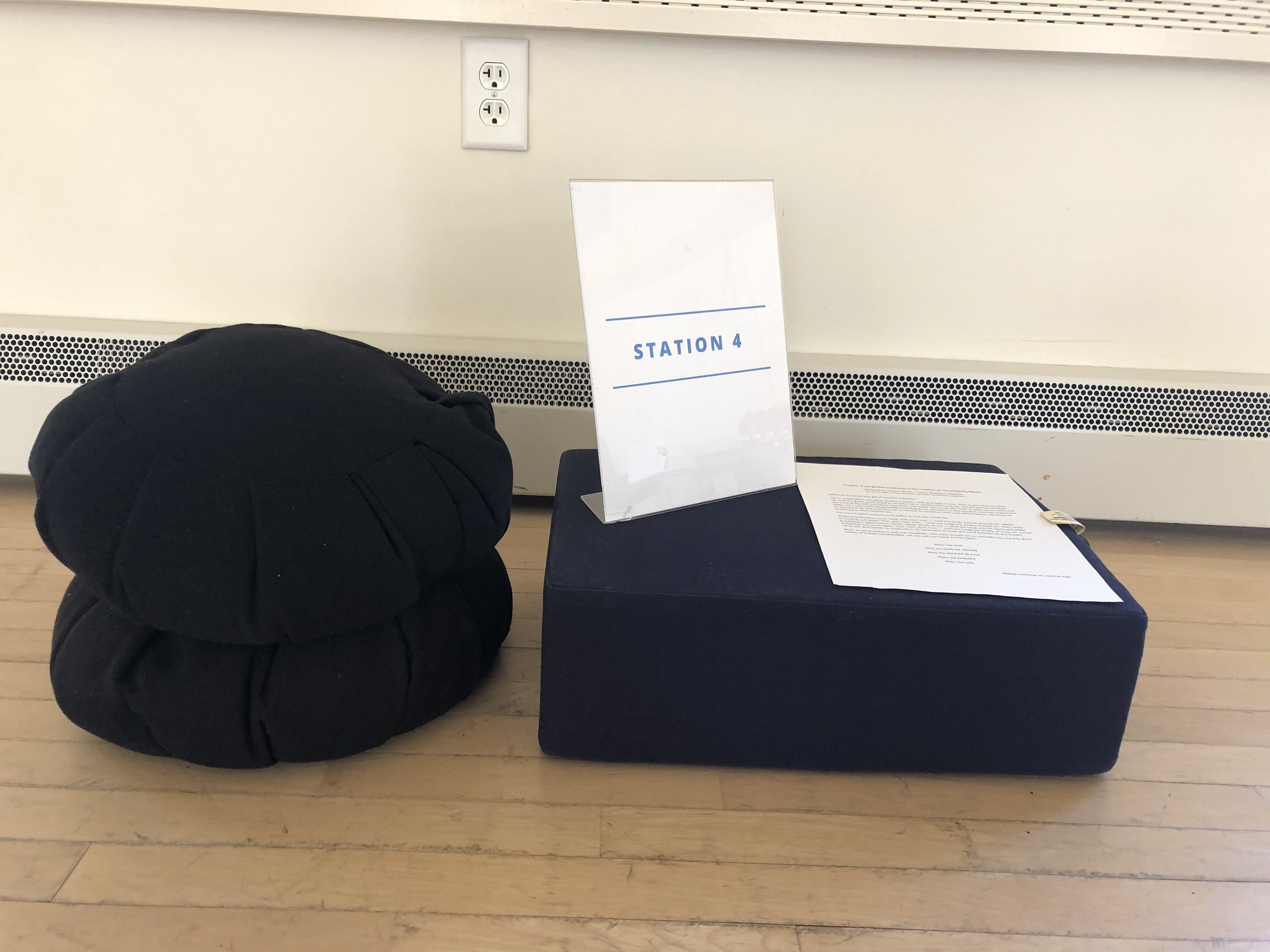 Meditation cushions with Station 3 sign