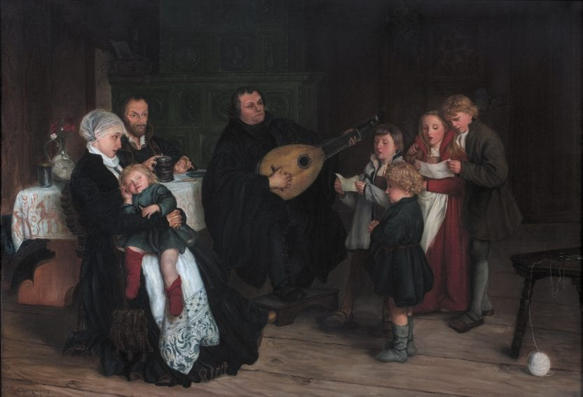 A rendition of Martin Luther, sitting among family in 1875